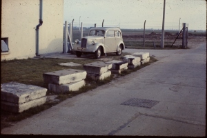 Mystery tiles stored for years on the airfield. Believed to be part of the manoeuvring area surface. photo (and car) by Mike Bloodworth