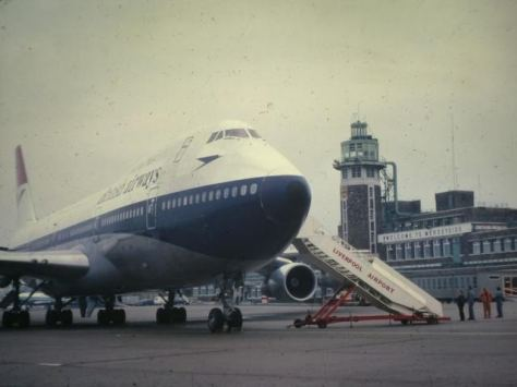 First Boeing 747 to land at Liverpool with tower and terminal behind.